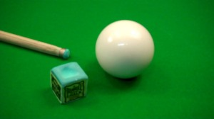 A cueball on a pool table